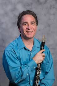 man holding woodwind