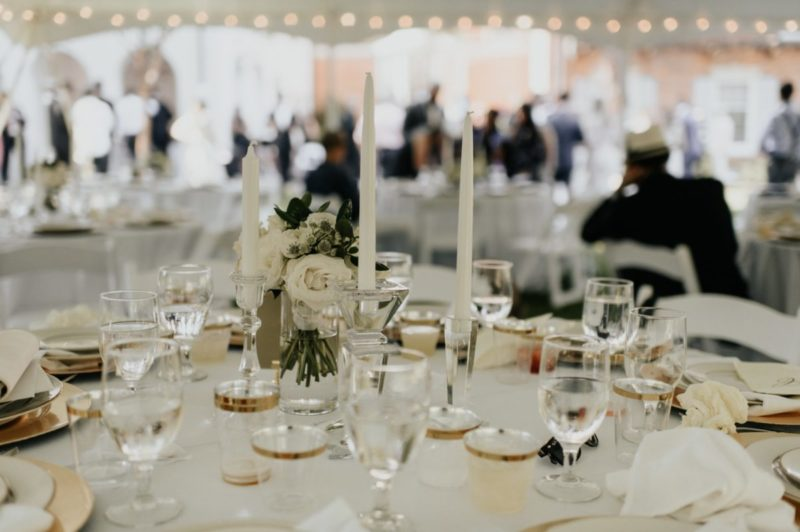 Table setting for wedding with candles and glassware